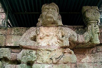 Copán - One of two simian sculptures on Temple 11, possibly representing howler monkey gods.