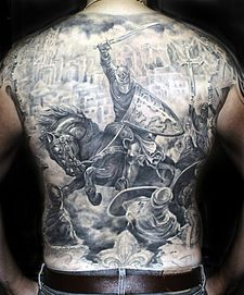 Black And Gray Tattoo Illustrating The Crusades That Encompasses Entire Backside Shading Technique On Shield Other Elements Is Pronounced