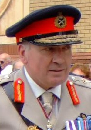 Scrambled egg (uniform) - General Sir Richard Dannatt wearing a forage cap with gold oak leaf embellishments.
