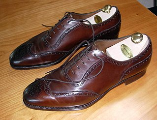 Brogue shoe style of low-heeled shoe or boot