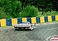 Dauer 962 LM - Mauro Baldi, Yannick Dalmas & Hurley Haywood exits Arnage at the 1994 Le Mans (31130417994).jpg