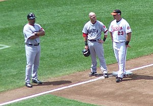 DeMarlo Hale - Hale (left) looks on as Dustin Pedroia converses with Ty Wigginton during a pitching change.
