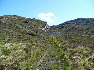 Assisted natural regeneration - Deer fence and gate on the Tubeg track. This part of the south side of Loch Assynt has been fenced off to assist natural regeneration of the tree cover. So far, there are few trees showing, despite the OS mapping showing this as a wooded area.