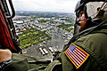Defense.gov News Photo 111028-M-XXXXM-419 - U.S. Navy Chief Petty Officer Nick Hall looks at flooded neighborhoods during an aerial assessment of Pathum Thani Sai Mai and surrounding areas.jpg