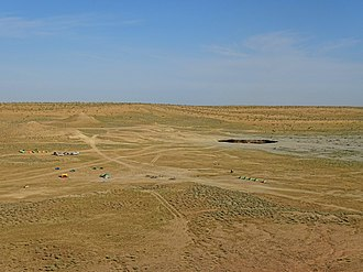 Darvaza gas crater - The Darvaza gas crater and the surrounding area, including where the tents usually are pitched, a couple of hundred meters away to the south of the crater.