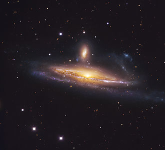 NGC 1531 - NGC 1531 (above) with large barred spiral galaxy NGC 1532