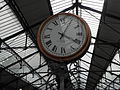 Earl's Court tube stn District concourse clock 2012.JPG