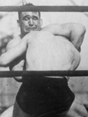 Ed Lewis (wrestler) - Lewis applies a headlock to Ivan Linow, 1920
