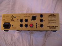 The rear panel of an amplifier unit is shown. Various jacks for plugging inputs and outputs are provided.
