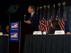 Phil Murphy - Murphy (far right) in his role as DNC Finance Chair as Senator John Edwards speaks at the DNC Fall Meeting in November 2007