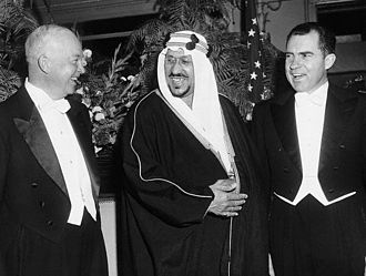 Eisenhower and Vice President Richard Nixon with their host, King Saud of Saudi Arabia, at the Mayflower Hotel (1957) Eisenhower and Nixon at Dinner with King Saud.jpg