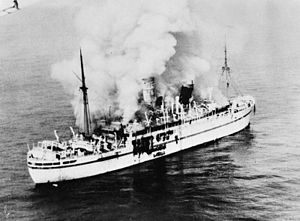 MV Empire Windrush - An aerial photograph of the burning Empire Windrush, March 1954
