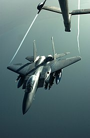 An F-15E Strike Eagle disengages from a KC-10 Extender