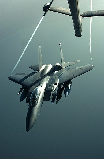 Wingtip vortices are visible trailing from an F-15E as it disengages from midair refueling with a KC-10 during Operation Iraqi Freedom F-15 wingtip vortices.jpg