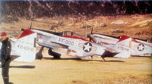Osan Air Base - North American F-51D-25-NT Mustangs of the 67th Fighter-Bomber Squadron (18th FBG). AF Serial No. 44-84916 and 44-75000 identifiable.
