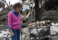 FEMA - 33538 - Resident looks through the ashes of her burned garage in California.jpg