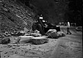 File-B&W negative of rock slide. Removing rocks from road with tractor- bystanders watching. -scratches, pits- ; ZION Museum and (b9e3a678801246788a653a6b68a68af8).jpg