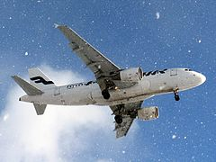 Finnair Airbus A319-112 OH-LVL snowfall.jpg