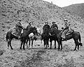 Five deer hunters on horseback with dogs (6468795209).jpg