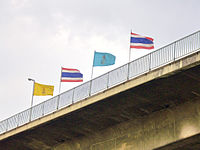 Flags of Thailand, King Rama IX and Queen Sikikit at King Taksin Bridge (close-up).JPG