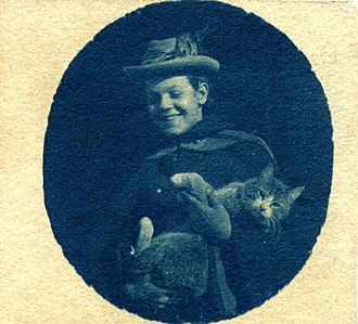 Florence Luscomb - Florence Luscomb holding her cat Needles, ca. 1893