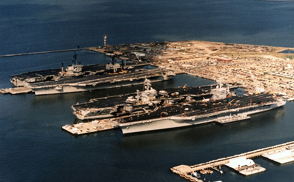 Four US Navy carriers at Norfolk Naval Station 1985.jpeg
