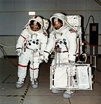 Fred Haise (left) and Ed Mitchell during EVA training. Mitchell is carrying the tool gate, indicating that they are loading the LRV.jpg