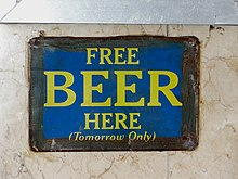A sign advertising free beer (obtainable without payment).
