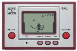 The Microvision, considered the first handheld video game, included interchangeable faceplates (the lighter piece) to play different games, also a first for handhelds.