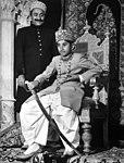 George Ali Murad Khan seated on throne