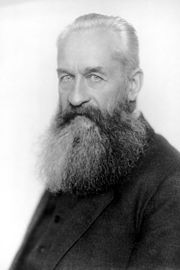 Head and shoulders black-and-white portrait of an elderly Lvov with pale eyes and a large grey beard