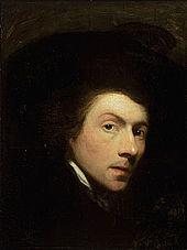 Zvýrazní obličej slavnostní mladého muže, který je obklopen tmavém pozadí.