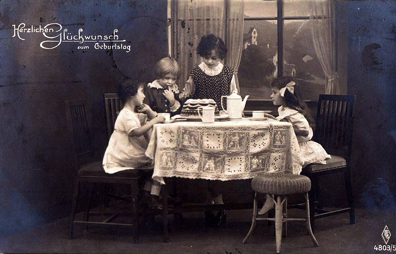 File:Girls with birthday cake. Postcard from 1920.jpg