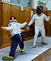 Greek Epee Fencers. Fencing at Athenaikos Fencing Club early in the evening.jpg
