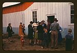Group of homesteaders in front of the bean house 1a34126v.jpg