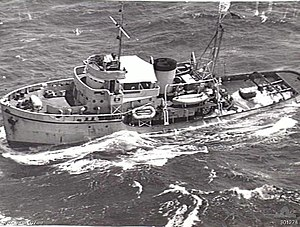 An aerial photograph of the tugboat HMAS Reserve at sea