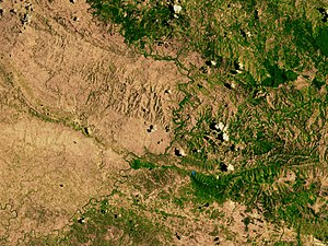 Environmental issues in Haiti - A satellite image of the border between the denuded landscape of Haiti (left) and the Dominican Republic (right).
