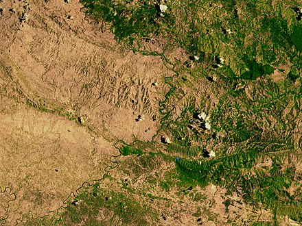 A satellite image of the border between the denuded landscape of Haiti (left) and the Dominican Republic (right), highlighting the deforestation on the Haitian side Haiti deforestation.jpg