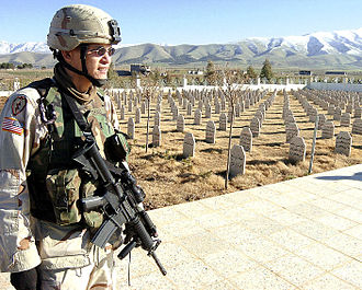 Halabja chemical attack - A First Lieutenant of the U.S. 25th Infantry Division patrolling a local cemetery for some 1,500 victims in 2003