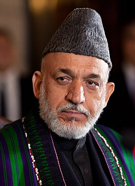 Hamid Karzai listens to Barack Obama in Kabul 2012 (cropped)