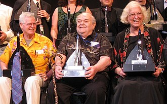 Connie Willis - David Hartwell, Charles N. Brown, and Connie Willis pose with the 2008 Hugo Awards