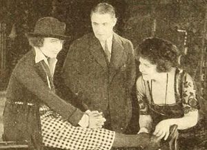 Photoplay - Still from the American film Her Lord and Master (1921), published on page 52 of Photoplay magazine.
