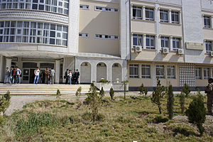 Education in Afghanistan - Students standing in front of the main campus of Herat University in western Afghanistan.