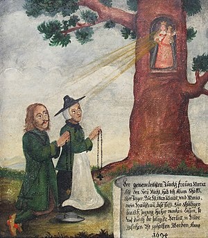 1694 in art - unknown artist, Votive tablet from the Heuwinkl Chapel in Iffeldorf. It depicts the Virgin Mary's image placed in a hollow oak tree which was the destination of many pilgrims