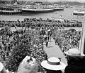 His Majesty King George VI and Her Majesty Queen Elizabeth coming up the walkway with a view of the harbour of Victoria in the background.jpg