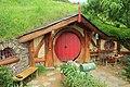 Hobbit hole with red door.jpg
