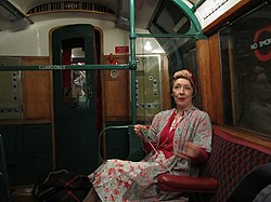Housewife knitting in Carriage (5029623910).jpg