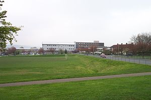 Huddersfield New College - Huddersfield New College in 2005, as viewed from New Hey Road. Both the original brick construction, and the more modern partial replacement can be seen