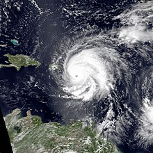 Satellite image of Hugo with Puerto Rico visible immediately to the west of the hurricane's cloudmass