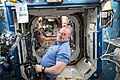 ISS-55 Scott Tingle prepares video equipment inside the Destiny lab.jpg